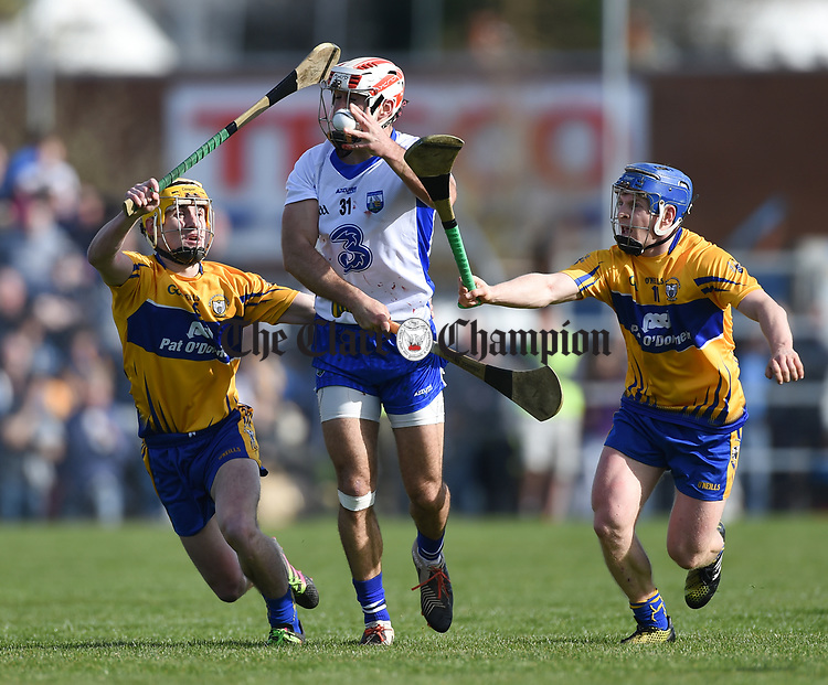 Stephen Daniels of Waterford  in action against Colm Galvin and Podge Collins of Clare during their National League game at Cusack Park. Photograph by John Kelly.