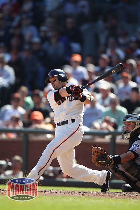 SAN FRANCISCO - SEPTEMBER 20:  Marco Scutaro of the San Francisco Giants bats during the game against the Colorado Rockies at AT&T Park on September 20, 2012 in San Francisco, California. (Photo by Brad Mangin)