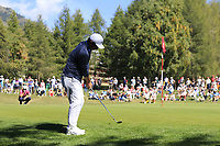 Doug Ghim (USA) chips onto the 5th green during Saturday's Round 3 of the 2018 Omega European Masters, held at the Golf Club Crans-Sur-Sierre, Crans Montana, Switzerland. 8th September 2018.<br /> Picture: Eoin Clarke | Golffile<br /> <br /> <br /> All photos usage must carry mandatory copyright credit (&copy; Golffile | Eoin Clarke)