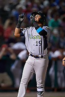 Vermont Lake Monsters third baseman Javier Godard (19) points skyward as he crosses home plate after hitting a home run in the top of the ninth inning during a game against the Tri-City ValleyCats on June 16, 2018 at Joseph L. Bruno Stadium in Troy, New York.  Vermont defeated Tri-City 6-2.  (Mike Janes/Four Seam Images)