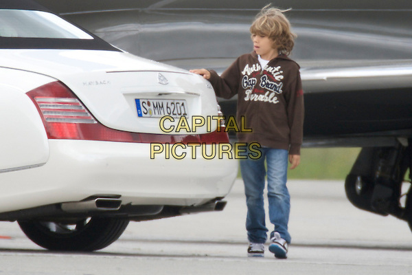 ELIAS (SON).Arriving for the wedding of Boris Becker and  Sharlely Lilly Kerssenberg, Engadine Airport, St. Moritz, Germany..June 11th, 2009.gv general view car white family kid child .CAP/PPG.©People Picture/Capital Pictures