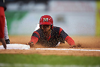 Batavia Muckdogs right fielder Jhonny Santos (32) slides head first into third base during the second game of a doubleheader against the Mahoning Valley Scrappers on August 17, 2016 at Dwyer Stadium in Batavia, New York.  Batavia defeated Mahoning Valley 5-3. (Mike Janes/Four Seam Images)
