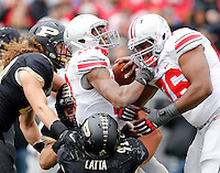 Ohio State Buckeyes quarterback Kenny Guiton (13) gets a push from offensive linesman Darryl Baldwin (76) into the end zone for a touchdown over Purdue Boilermakers defensive end Greg Latta (91) and linebacker Collin Link (40) during the second half of the NCAA football game at Ross-Ade Stadium in West Lafayette, Ind. on Nov. 2, 2013. (Adam Cairns / The Columbus Dispatch)