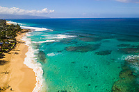 Looking west along Sunset Beach, North Shore of O'ahu, seen from above.