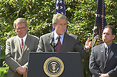 "United States President George W. Bush names John P. Walters to be the ""Drug Czar"" in the Rose Garden of the White House in Washington, D.C. on May 10, 2001.  From left to right: John P. Walters, President George W. Bush, and Henry Lozano..Credit: Ron Sachs / CNP"
