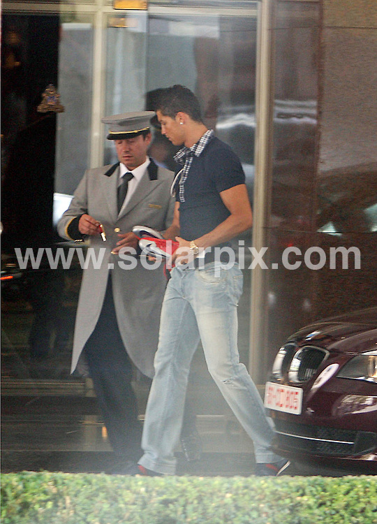 **EXCLUSIVE PICTURES FROM SOLARPIX.COM**.**WORLDWIDE SYNDICATION RIGHTS EXCEPT FOR PORTUGAL AND SPAIN** **NO PUBLICATION IN PORTUGAL OR SPAIN**.Reports today suggest that the new Real Madrid signing, Cristiano Ronaldo, abused a female fan two days before these pictures were taken at his villa in Lisbon, allegedly kicking her car and smashing a window..This picture:   Cristiano Ronaldo leaving his hotel in Lisbon yesterday, after his brother arrived to collect his new Girlfriend and leave the Ferrari for him..JOB REF:  9376   NPP     DATE:  01.07.09.**MUST CREDIT SOLARPIX.COM OR DOUBLE FEE WILL BE CHARGED**.***ONLINE USAGE FEE GBP 50.00 PER PICTURE - NOTIFICATION OF USAGE TO PHOTO @ SOLARPIX.COM**.**CALL SOLARPIX : +34 952 811 768 or LOW RATE FROM UK 0844 617 7637**