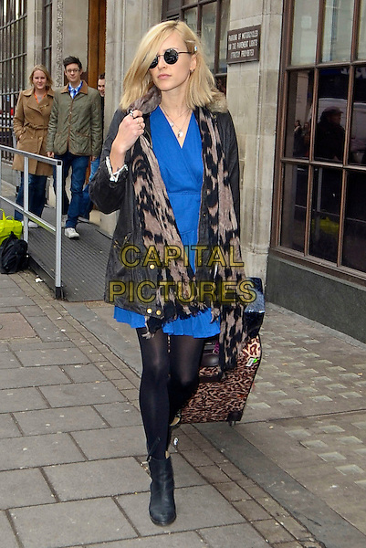 Fearne Cotton .Leaving BBC Radio 1, London, England, UK, December 2nd 2011..full length blue cobalt dress sunglasses ankle boots  leopard print suitcase on wheels luggage barbour jacket scarf grey gray .CAP/DYL.©Dylan/Capital Pictures.