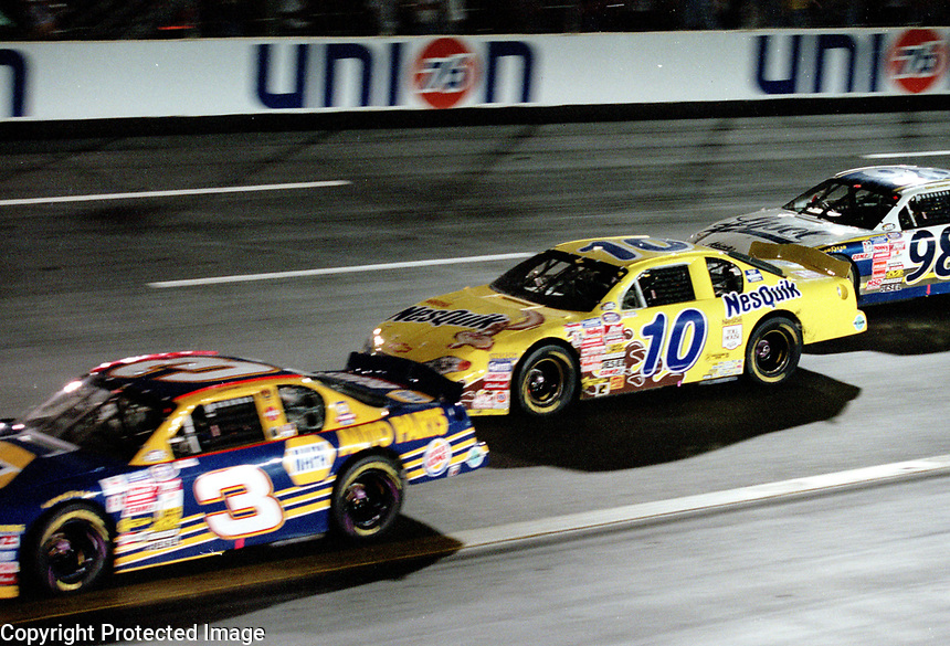 2000 NASCAR Busch Series Chapmion Jeff Green (#10) races with Ron Hornaday(#3) and Elton Sawyer (#98) at Richmond in September 2000.(Photo by Brian Cleary)