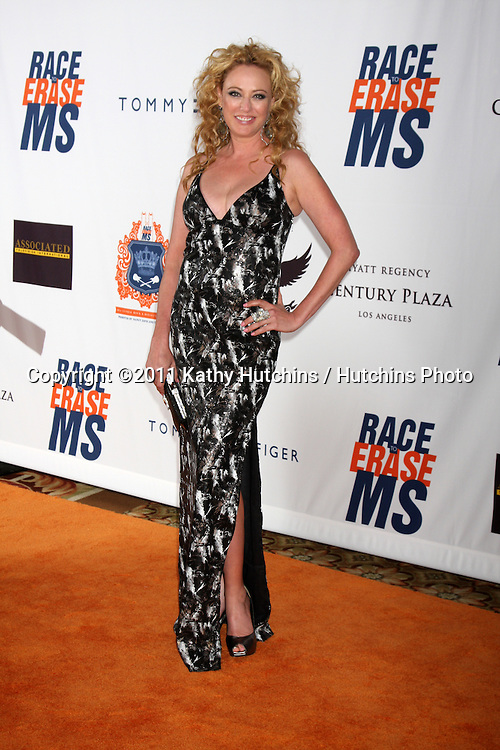 LOS ANGELES - APR 29:  Virginia Madsen arriving at the 18th Race to Erase MS Event at Century Plaza Hotel on April 29, 2011 in Century City, CA..