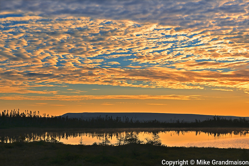 Clouds at sunset over pond<br /> Hawke's Bay<br /> Newfoundland & Labrador<br /> Canada