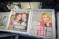 Front pages and headlines of the New York Post and Daily News tabloid newspapers on Friday, August 29, 2014 cover the two major celebrity stories. Surprisingly the Post focused on the marriage of Brad Pitt and Angelina Jolie while the Daily News stuck to a more local angle covering the hospitalization of comedienne Joan Rivers. Usually the tabloids, which are competing with each other, have the same headline. (© Richard B. Levine)