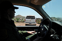 Tucson, Arizona - U.S. Customs Border Protection (CBP) Public Affairs Officer Jeremy Copeland gives a tour of the U.S.-Mexico border to a group of journalists. He transported reporters to during a two-day event organized by the Tucson Sector Border Patrol. The event brought national and international journalists to the Arizona border to become acquainted with the dynamics of this area. Photo by Eduardo Barraza © 2012