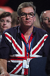 © Joel Goodman - 07973 332324 . No syndication permitted . 29/09/2013 . Manchester , UK . A member of the audience wearing a Union Flag shirt . Day 1 of the Conservative Party Conference at Manchester Central . Photo credit : Joel Goodman