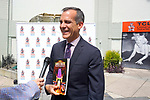 LOS ANGELES - JULY 24: LA Mayor Eric Garcetti at the handing over of the first-ever complete, commemorative & official full-color Souvenir Program for the 90 year-old TCL Chinese Theatre, beautifully relating both the Theatre's glorious history in full color and comprehensive text and historic anecdotes and that of Hollywood outside the TCL Chinese Theatre IMAX on July 24, 2017 in Los Angeles, California