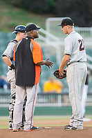 Delmarva Shorebirds pitching coach Alan Mills (75) has a chat with starting pitcher Mitch Horacek (27) during the game against the Kannapolis Intimidators at CMC-NorthEast Stadium on July 1, 2014 in Kannapolis, North Carolina.  The Intimidators defeated the Shorebirds 5-2. (Brian Westerholt/Four Seam Images)