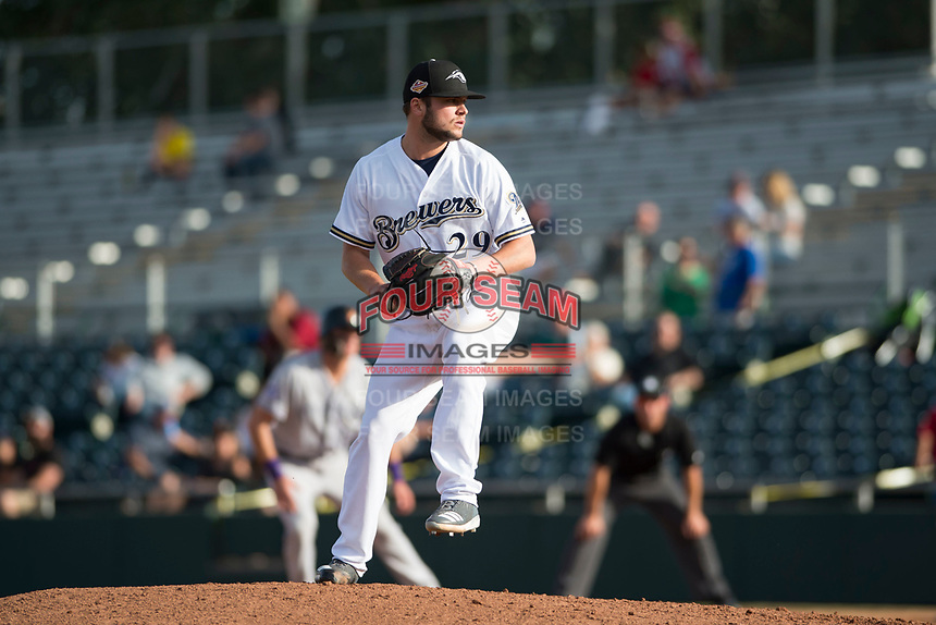 Peoria Javelinas relief pitcher Jon Olczak (29), of the Milwaukee Brewers organization, delivers a pitch during the Arizona Fall League Championship Game against the Salt River Rafters at Scottsdale Stadium on November 17, 2018 in Scottsdale, Arizona. Peoria defeated Salt River 3-2 in 10 innings. (Zachary Lucy/Four Seam Images)