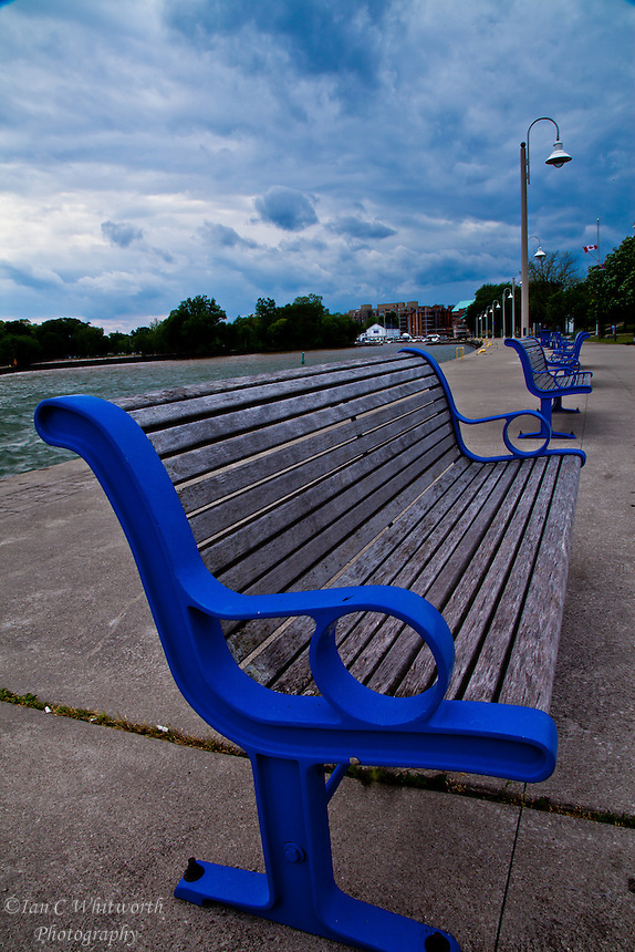 The freshly painted blue framed benches in Bronte Harbour, Oakville