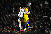 Tim Ream of Fulham under pressure from Jordon Garrick of Swansea City during the Sky Bet Championship match between Fulham and Swansea City at Craven Cottage on February 26, 2020 in London, England. (Photo by Athena Pictures/Getty Images)