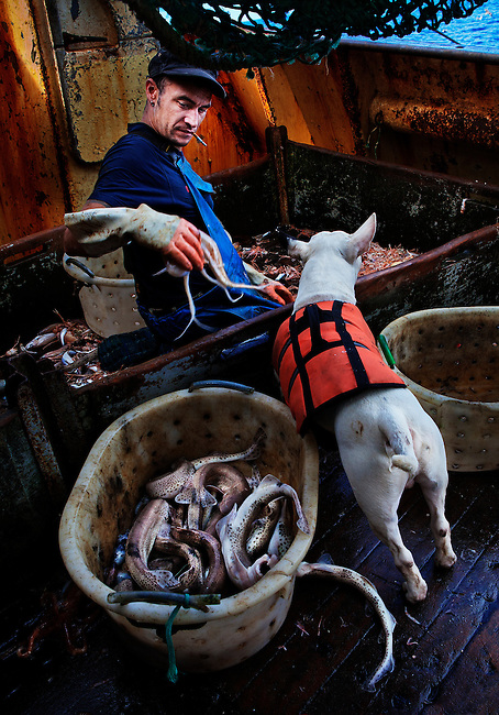Carl and his dog, Keta, at sea aboard the trawler 'Risten', whose home port is Le Guilvinec, France.  <br />