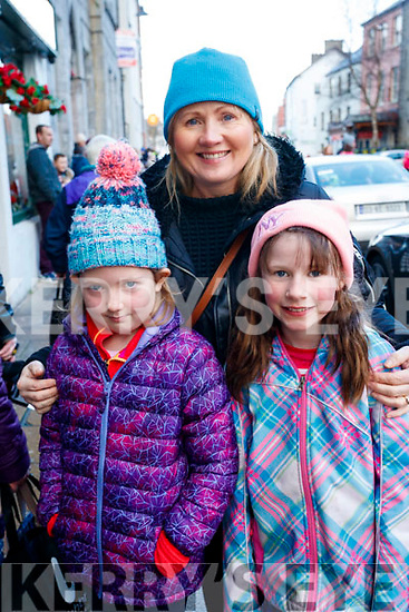 Clodagh and Jactina Bourke with Brid O'Sullivan, Lissanearla, Tralee, enjoying the CH Chemist Santa parade in Tralee on Saturday afternoon last.