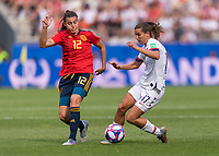 REIMS,  - JUNE 24: Patri Guijarro #12 defends Tobin Heath #17 during a game between NT v Spain and  at Stade Auguste Delaune on June 24, 2019 in Reims, France.