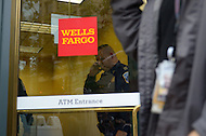 October 13, 2011  (Washington, DC)  A DC police Captain enters a Wells Fargo Bank branch in downtown Washington as members of the group October2011 protested outside.  At one point, protesters went inside the bank. Police removed the protesters with no arrests, but the branch closed while protesters remained outside.   (Photo by Don Baxter/Media Images International)