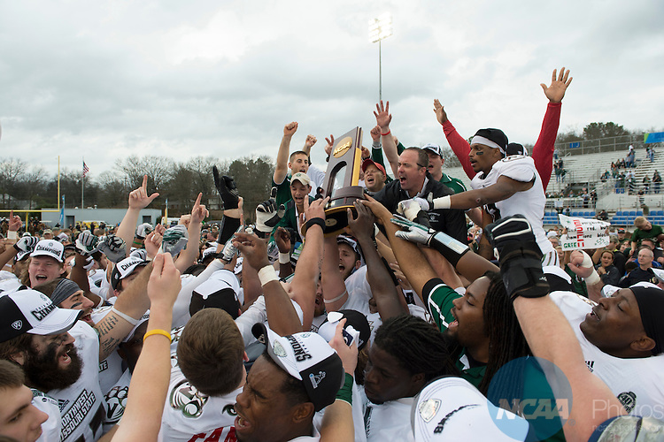 21Dec2013: Members of Northwest Missouri State University pose with the trophy during the Division II Men's Football Championship held at Braly Municipal Stadium in Florence, AL. Northwest Missouri State defeated Lenoir-Rhyne 43-28 to win the national title. Justin Tafoya/NCAA Photos