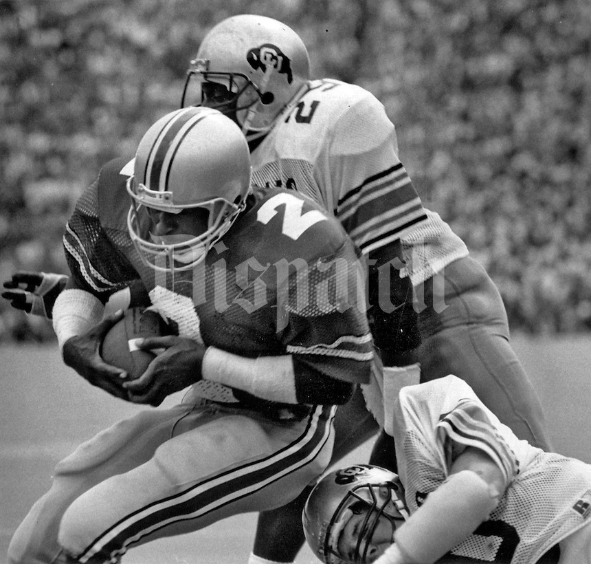 Third quarter touchdown play with OSU's Cris Carter as the ball carrier against Colorado, played Sept. 20, 1986. (Dispatch photo by Fred Squillante)