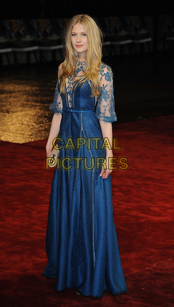 "LAURA BRENT.The Royal Film Performance 2010: The World Premiere of ""Chronicles of Narnia: The Voyage of the Dawn Treader"" at the Odeon, Leicester Square, London, England,.November 30th 2010..full length teal blue lace sleeve long maxi dress beige clutch bag sheer see thru through .CAP/WIZ.© Wizard/Capital Pictures.."