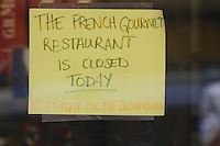 May 15 2008, Pacific Beach, San Diego, CA, USA:  A sign on the front door of the French Gourmet resturant on Turquoise Street after it was rraided earlier in the day. Eyewitnesses said that the street was closed for a block or two during the raid just before 8am.