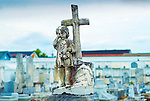 Statue of little girl in Saint Roch Cemetery in New Orleans.  Saint Roch is the patron Saint of Miraculous Cures.