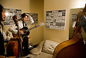 "Scott Avett works through a song from the Avett Brothers' upcoming EP ""The Second Gleam""  with Joe Kwon, far left, and Bob Crawford, backstage at the Birchmere in Alexandria, VA, Friday, June 20, 2008."
