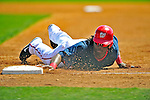 10 March 2009: Washington Nationals outfielder Lastings Milledge dives safely back to first during a Spring Training game against the New York Mets at Space Coast Stadium in Viera, Florida. The Nationals and Mets tied 5-5 in the 10-inning Grapefruit League matchup. Mandatory Photo Credit: Ed Wolfstein Photo
