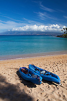 Kayaks on the beach at Napili Bay, Maui.