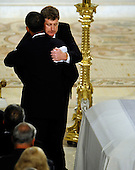 Boston, MA - August 29, 2009 -- Congressman Patrick Kennedy hugs President Barack Obama  (facing away from camera) next to the casket of his father Senator Edward Kennedy at the Basilica of Our Lady of Perpetual Help Catholic Church in Boston, Massachusetts, USA for the funeral Mass for Kennedy 29 August 2009. Senator Edward Kennedy, 77, died 25 August 2009 after a battle with brain cancer.  .Credit: CJ  Gunther - Pool via CNP