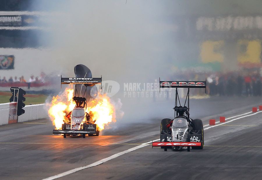 Sept. 2, 2013; Clermont, IN, USA: NHRA top fuel dragster driver Billy Torrence (right) defeats Spencer Massey who exploded an engine during the US Nationals at Lucas Oil Raceway. Mandatory Credit: Mark J. Rebilas-