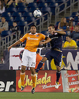 Houston Dynamo forward Brian Ching (25) and New England Revolution defender A.J. Soares (5) battle for head ball. In a Major League Soccer (MLS) match, the New England Revolution tied Houston Dynamo, 1-1, at Gillette Stadium on August 17, 2011.