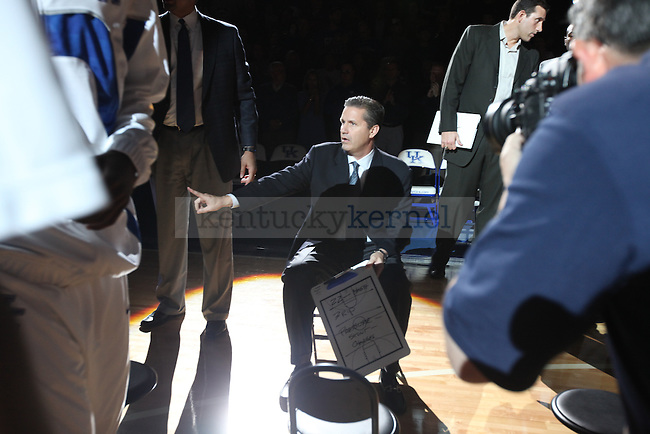 UK men's basketball head coach John Calipari plans out the game against Campbellsville at Rupp Arena on Monday night, Nov. 2, 2009.