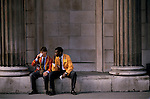 LIFFE, London International Financial Futures Exchange. Young traders having a lunch break. Sitting on the wall of the Bank of England. This  was all pre-computer trading, and is where deals were struck, Derivates, Options and Futures were bought and sold by shouting across the trading floor know at the 'Bear Pit' and frantic gesturing. They wore different coloured jackets so that colleagues could pick each other out in the frenzy of a days work.