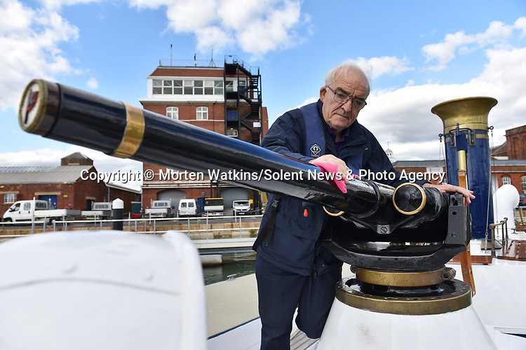 Pictured: Restoration volunteer Martin Marks polishes the Pinnace 199's gun, an original 1887 Hotchkiss which was dredged up from the North Sea and re-commissioned in 1984.<br /> <br /> An historic 100 year old Royal Navy steam ship has finally been returned to its former glory after a painstaking restoration process.<br /> <br /> The 50ft-long Steam Pinnace 199 is believed to be the last remaining boat of its type in operational service.<br /> <br /> For years, the significance of the boat, which was built in 1911, was lost on various owners and it languished at the side of the Thames for more than 20 years as a static houseboat.<br /> <br /> Her steam engine was even replaced by a petrol engine.<br /> <br /> However, before the vessel disappeared forever beneath a Thames mud bank, she was recognised for the proud little ship she once was and rescued by a group of volunteers, who called themselves Group 199.   SEE OUR COPY FOR DETAILS.<br /> <br /> <br /> © Morten Watkins/Solent News & Photo Agency<br /> UK +44 (0) 2380 458800