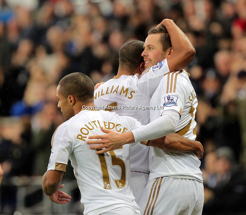 Gylfi Sigurdsson of Swansea celebrates his opening goal with team mates during the Barclays Premier League match between Swansea City and Crystal Palace at the Liberty Stadium, Swansea on February 06 2016