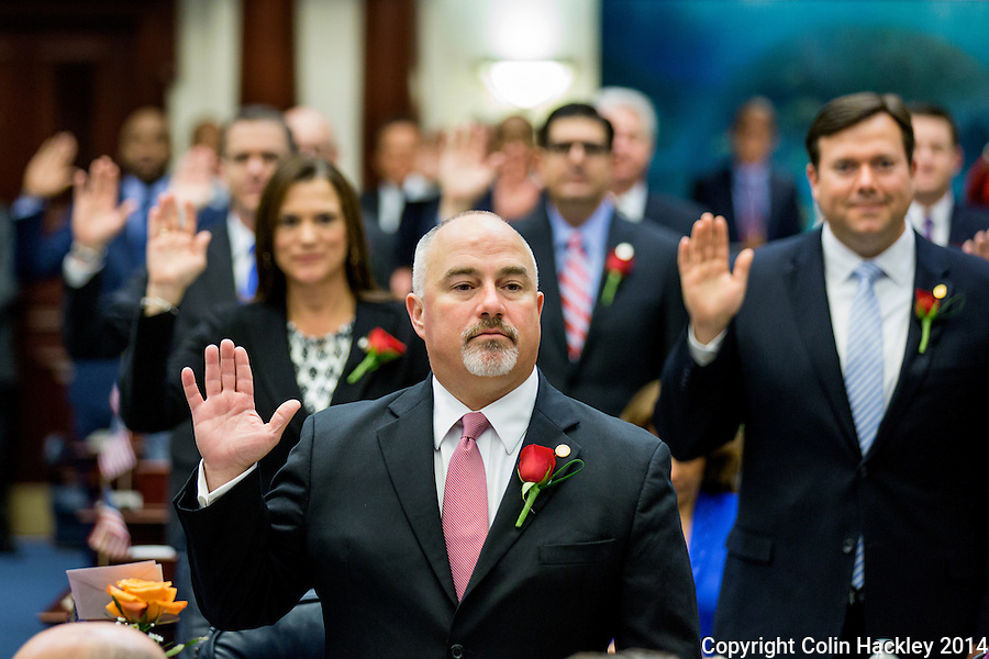 TALLAHASSEE, FLA. 11/18/14-ORGSESS111814CH-Rep. Matt Hudson, R-Naples, stands with other returning members of the House of Representatives as they take the oath of office during Organizational Session, Nov. 18, 2014 at the Capitol in Tallahassee.<br /> <br /> COLIN HACKLEY PHOTO