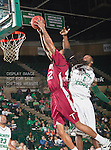 North Texas Mean Green forward Jacob Holmen (1) and Troy Trojans forward Tim Owens (42) in action during the game between the Troy Trojans and the University of North Texas Mean Green at the North Texas Coliseum,the Super Pit, in Denton, Texas. UNT defeats Troy 87 to 65.....