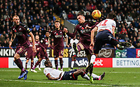 Bolton Wanderers' Will Buckley heads across the penalty area under pressure from Swansea City's Connor Roberts <br /> <br /> Photographer Andrew Kearns/CameraSport<br /> <br /> The EFL Sky Bet Championship - Bolton Wanderers v Swansea City - Saturday 10th November 2018 - University of Bolton Stadium - Bolton<br /> <br /> World Copyright © 2018 CameraSport. All rights reserved. 43 Linden Ave. Countesthorpe. Leicester. England. LE8 5PG - Tel: +44 (0) 116 277 4147 - admin@camerasport.com - www.camerasport.com