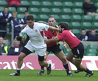 24/05/2002 (Friday).Sport -Rugby Union - London Sevens.England vs Spain.Henry Paul breaking throgh the Spanish defence[Mandatory Credit, Peter Spurier/ Intersport Images].