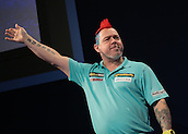 30.12.2015. Alexandra Palace, London, England. William Hill PDC World Darts Championship. Peter Wright waves to the Alexandra Palace crowd as he enters the stage