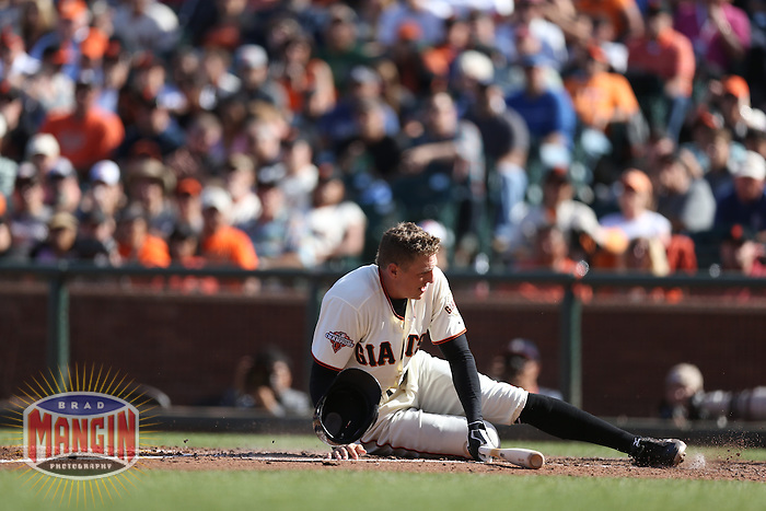 SAN FRANCISCO, CA - JULY 6:  Hunter Pence #8 of the San Francisco Giants gets knocked down by an inside pitch while batting against the Los Angeles Dodgers during the game at AT&T Park on Saturday, July 6, 2013 in San Francisco, California. Photo by Brad Mangin