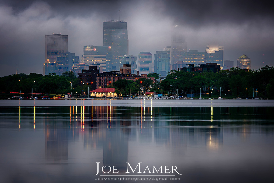 Minneapolis skyline over Lake Calhoun with low clouds from a clearing storm.