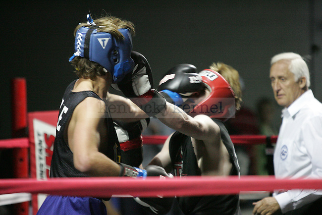 Adam Shipley (L) of Sigma Chi and Joseph Kaseta (R) of Triangle punch each other during their bout at The Main Event, where proceeds benefitted The Huntsman Cancer Institute and The Ronald McDonald House in Lexington, Ky. on 11/11/11. Photo by Quianna Lige | Staff
