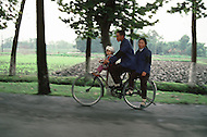 October 1984. Si Shuan Province, in the village of Xing Du, in the county of Guangham, bicycle is the number 1 transportation vehicle in China, it is not uncommon to see three, four or even five people in the same bike.